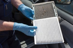 Replacing the pollen air filter.